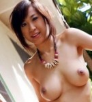 Cocolo posing outdoors in bikini her natural tits.