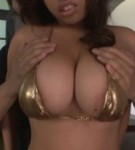 Curvy asian tina posing in a lascivious gold bikini her natural voluminous tits and fuck.