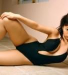 Hitomi kitamura natural boobs posing in a black swimming suite.