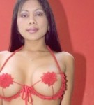 Exciting vietnamit girl posing her big breasts in red lingerie. Horny vietnamit girl posing her voluminous tits in red lingerie