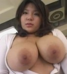Mitsuki an in the classroom playing with her natural big boobs.