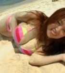 Harada orei posing her natural knockers at the beack in bikini.