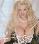 Blonde porn star crystal storm posing in a lascivious black lingerie her hard tits.