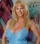 Penny porsche posing her mature considerable tits in a lascivious blue lingerie.